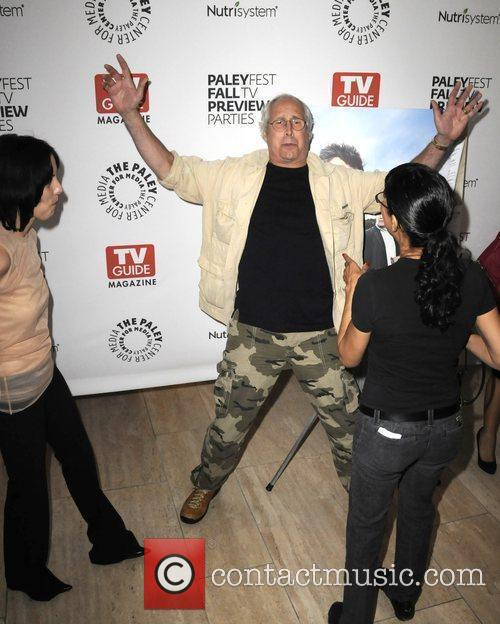 Chevy Chase in high spirits as he arrives...