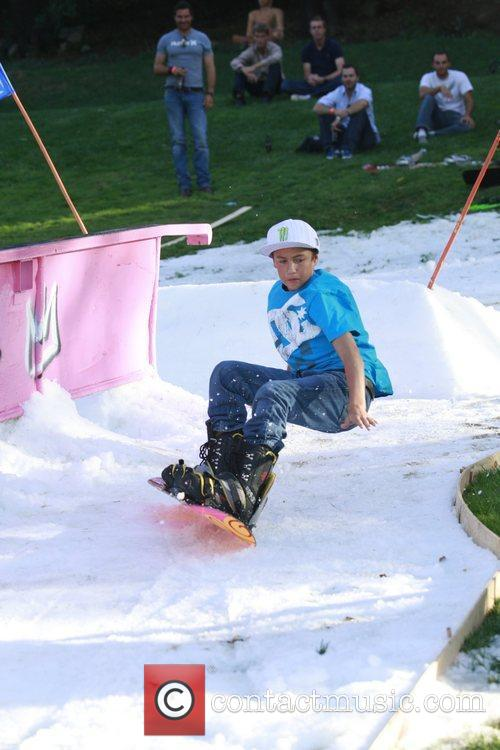 Attempts snowboarding in Topanga Canyon at a celebrity...