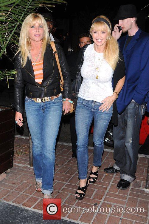 Pamela Bach (left) arriving for dinner at Madeo...