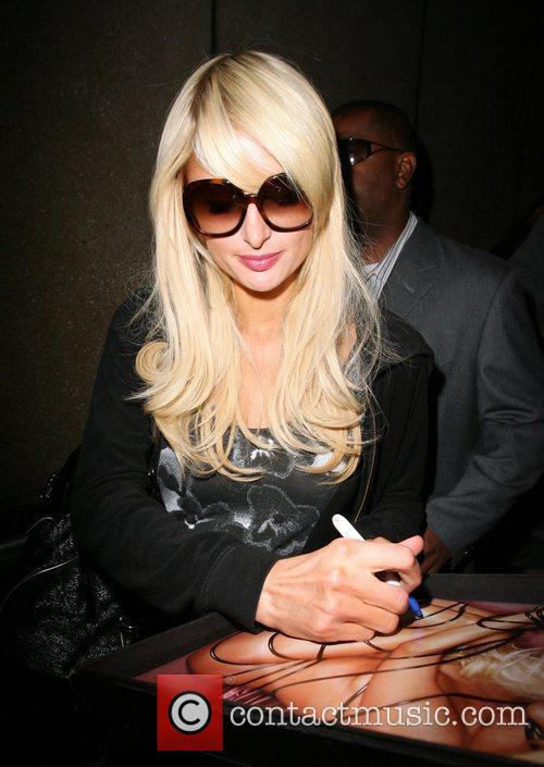 Paris Hilton arriving at LAX on a flight from New York.