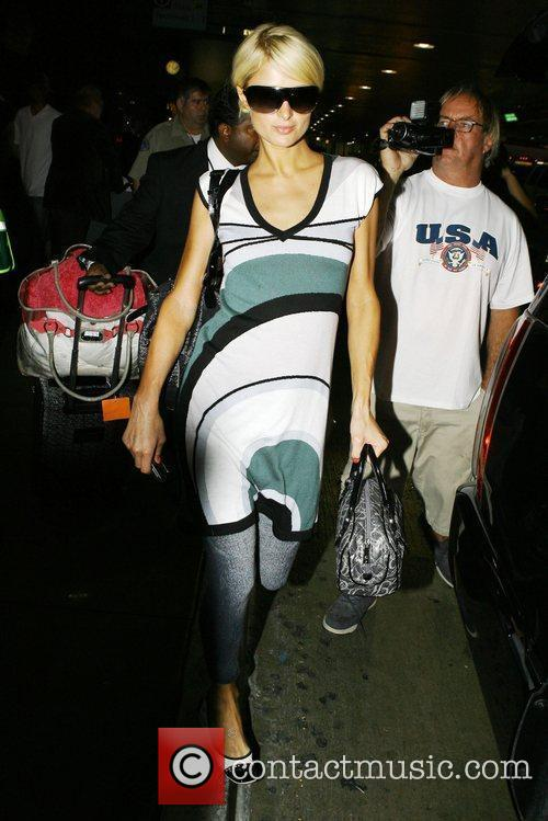 Arrives at LAX airport after catching a flight...