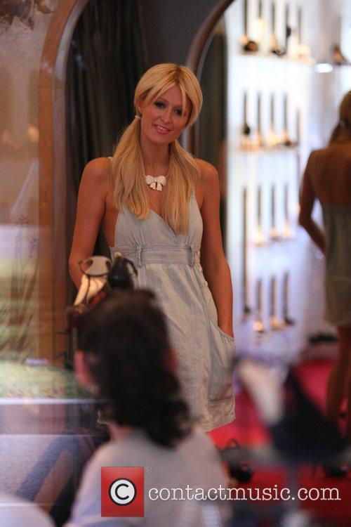 Paris Hilton shopping at Christian Louboutin with her...