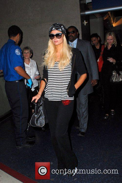 Paris Hilton arriving at LAX airport on a...