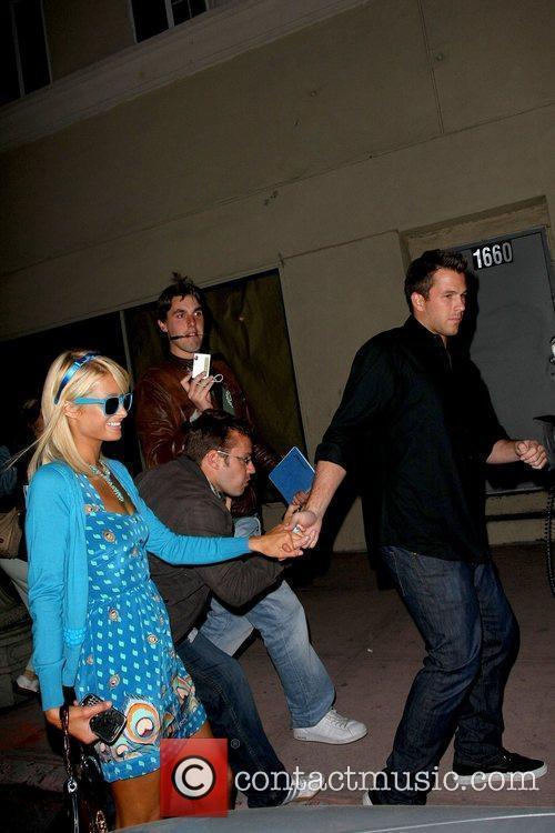 Paris Hilton and Doug Reinhardt waiting to pick...