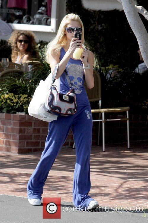 Paris Hilton takes photos of the awaiting photographers...