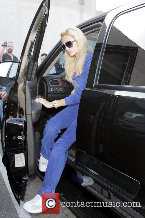 Paris Hilton arriving at Maxfield while wearing a...