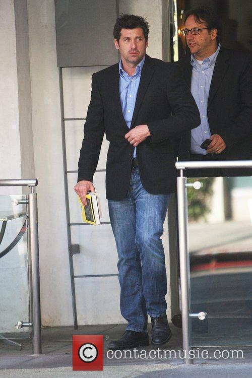 'Grey's Anatomy' star Patrick Dempsey carrying books, seen...