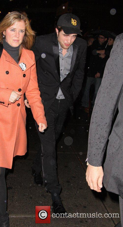 Robert Pattinson feeling the cold outside a lounge...