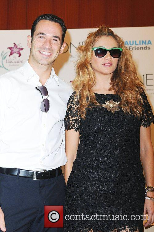 Helio Castroneves and Paulina Rubio Press conference for...