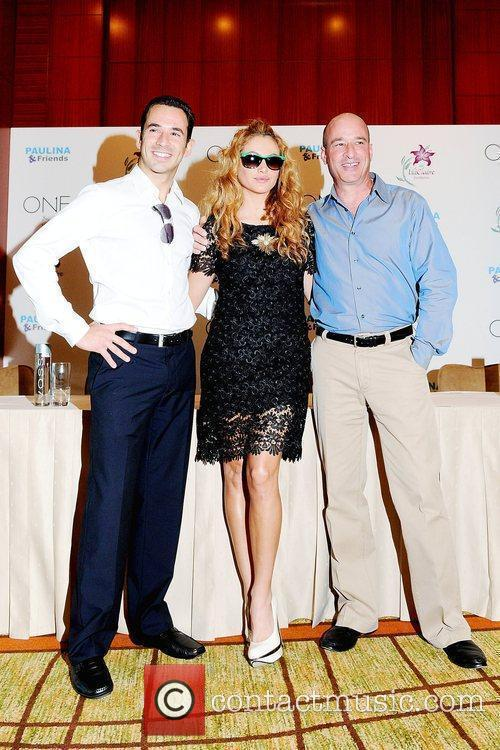 Helio Castroneves, Paulina Rubio and Keith Pesnich Press...