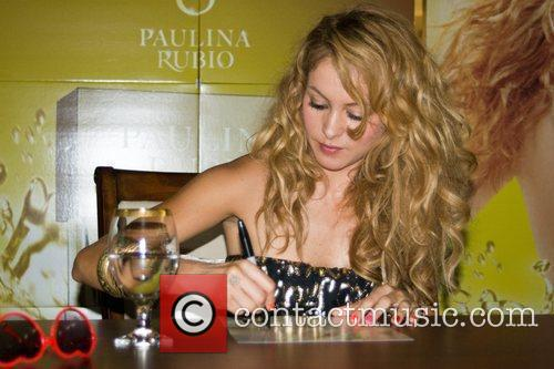 Paulina Rubio signs autographs for fans at an...