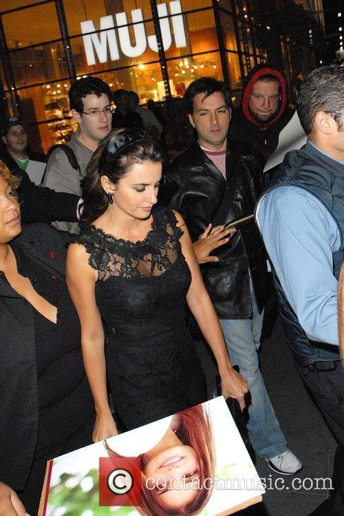 Penelope Cruz signs autographs for fans as she...