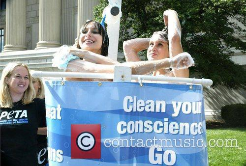 'Clean Your Conscience: Go Vegetarian!' Two nude women...