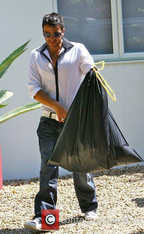 Peter Andre puts his rubbish out before leaving...