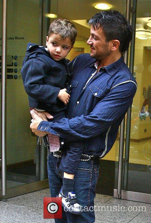 Arriving at a hotel with his son Junior...