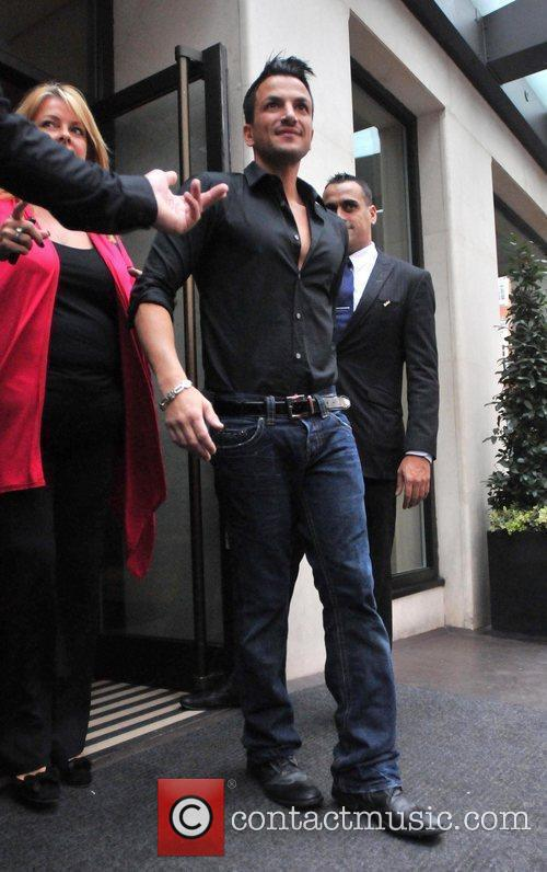Peter Andre leaves his hotel with his manager...