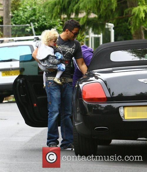 Peter Andre, with his daughter Princess Tiaamii moving...