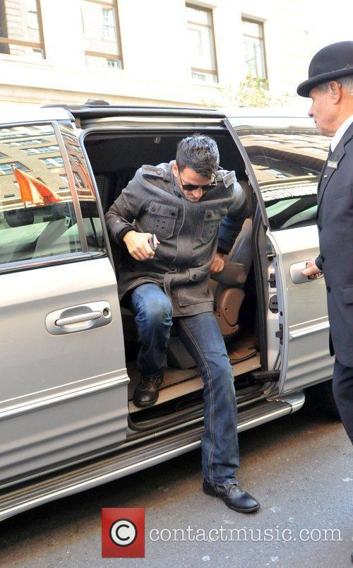 Arriving at his hotel in central London