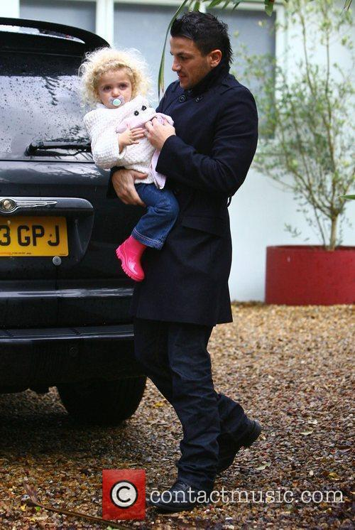 Peter Andre returns home with his daughter Princess...