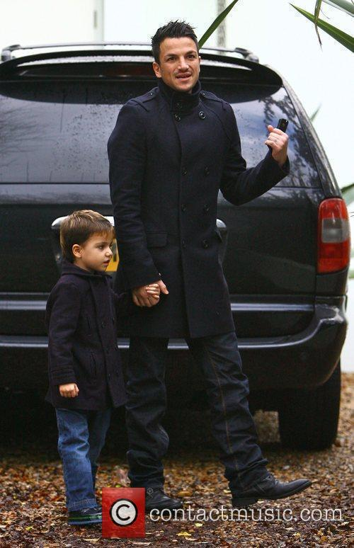 Peter Andre returns home with his son Junior...