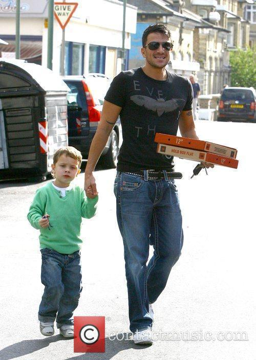 Peter Andre, with his friend's son, as he...