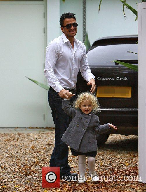 Leaving his house with his daughter Princess Tiaamii