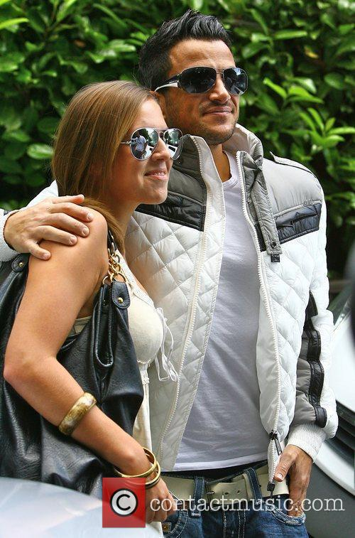 Peter Andre posing with a fan before heading...