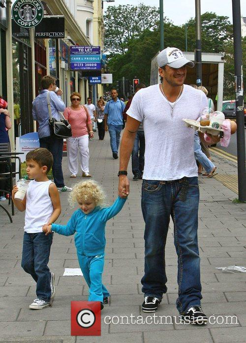 Peter Andre leaving Starbucks with his children Princess...