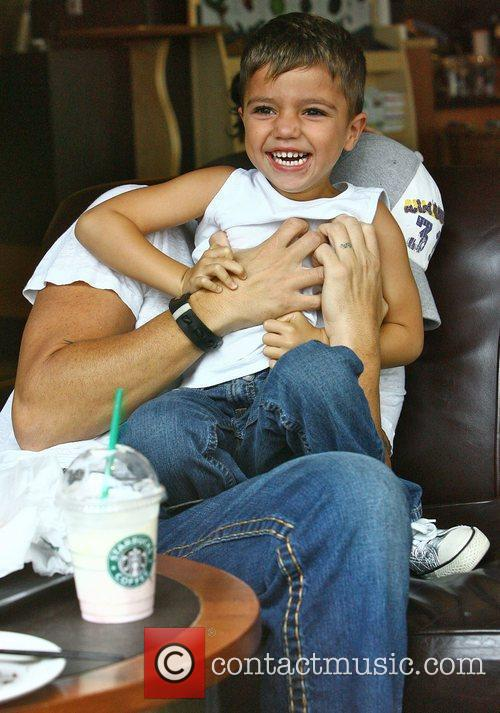 Peter Andre in Starbucks with his son Junior...
