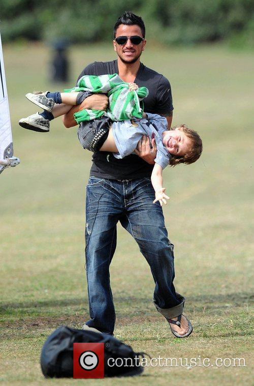 Peter Andre plays around with his windsurfing instructor's...
