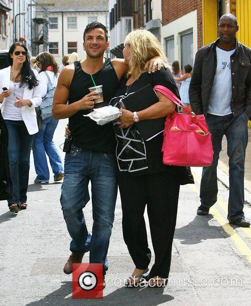 Peter Andre and his manager Claire Powell leaving...