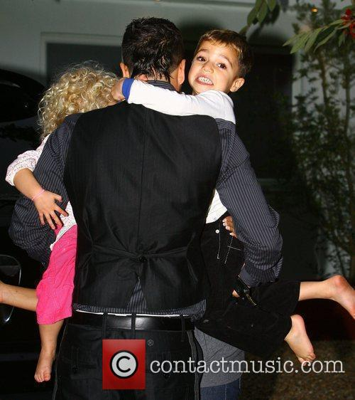 Peter Andre outside his house with his children...