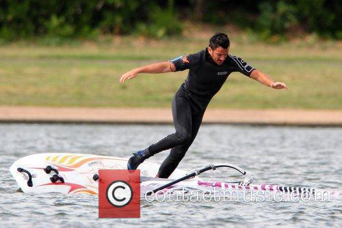 Peter Andre falls into the water during a...