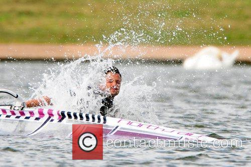 Peter Andre makes a splash during a windsurfing...