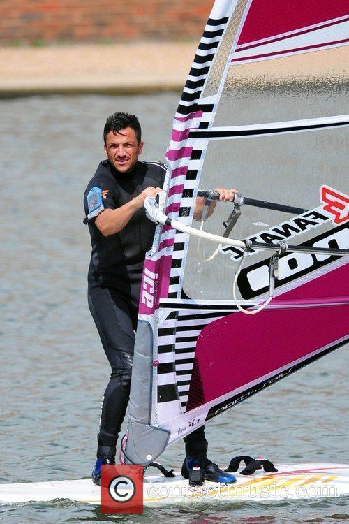 Peter Andre enjoys a windsurfing session. Brighton, England