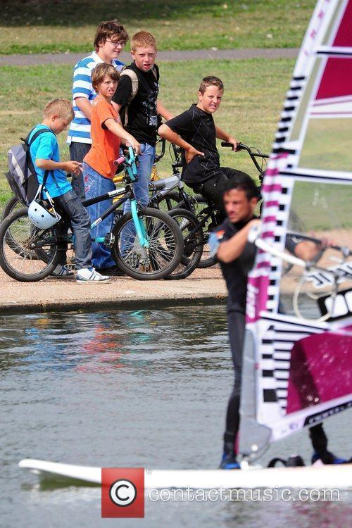 Peter Andre enjoys a windsurfing session, while being...