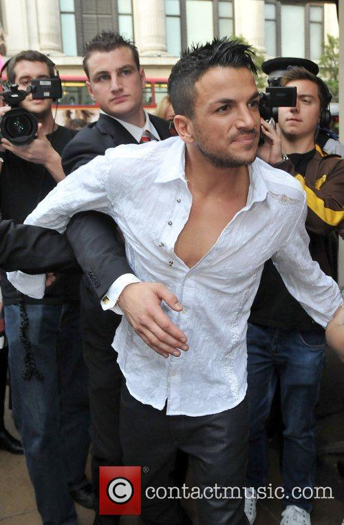 Peter Andre is mobbed outside the store after...