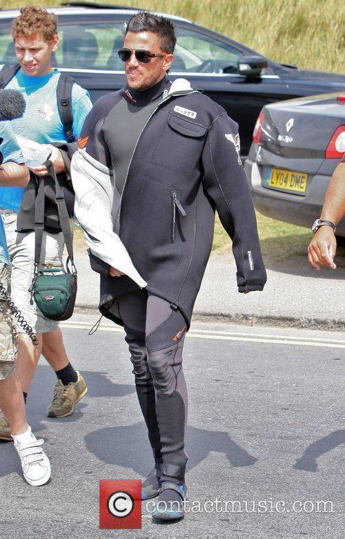 Peter Andre arrives for a windsurfing session. Brighton,...