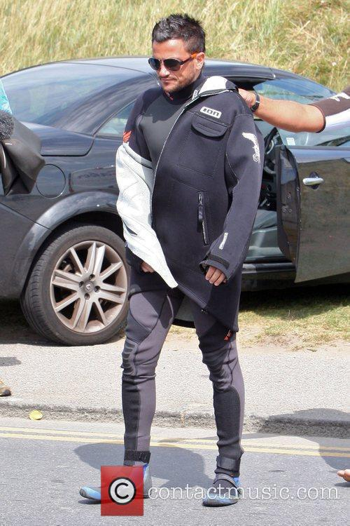 Peter Andre gets ready for a windsurfing session....