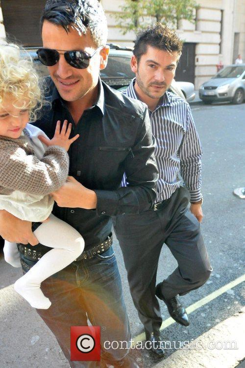 Peter Andre carries his daughter Princess Tiaamii outside...
