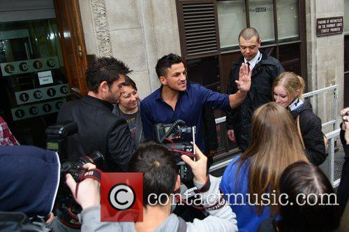 Peter Andre greets fans outside the Radio One...