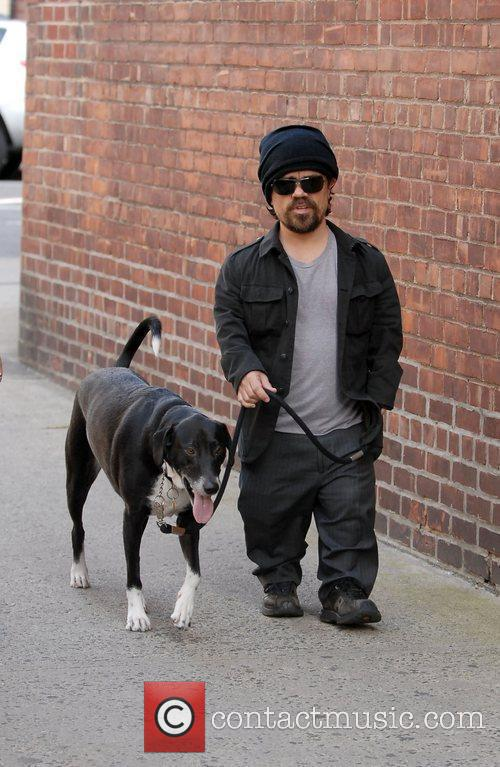 Walking his dog in the West Village