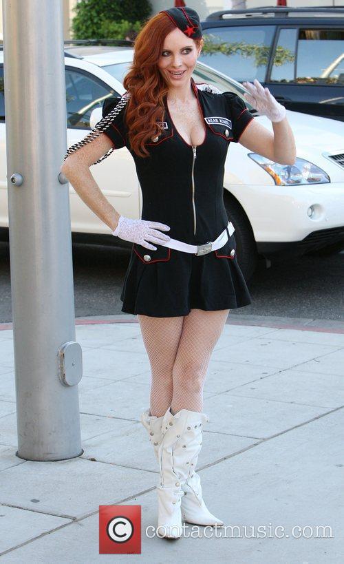 Posing in her Halloween costume