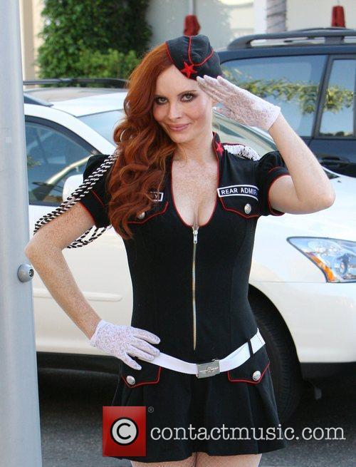 Phoebe Price posing in her Halloween costume Beverly...