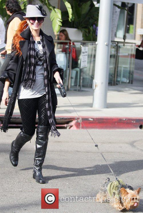 Phoebe Price takes her dog while out having...