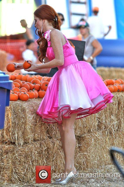 Wears a fancy pink dress during her visit...