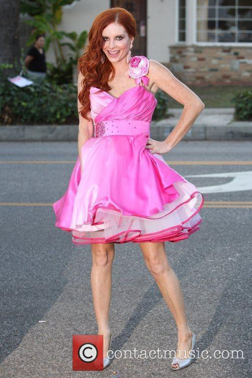 Phoebe Price wears a fancy pink dress during...