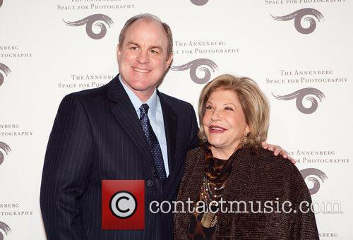 UCLA Basketball coach Ben Howland greets Wallis Annenberg...