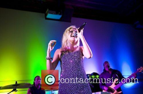 Pixie Lott performing live at the official launch...