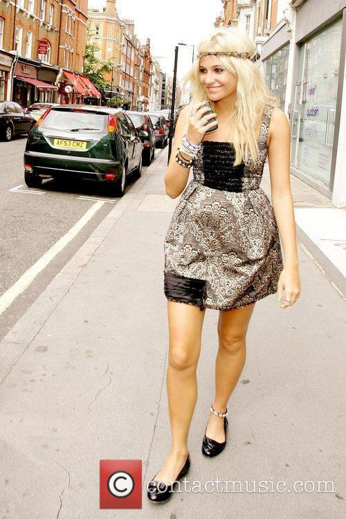 Pixie Lott  out and about while wearing...